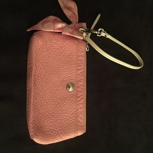 Coach pink wristlet with silk bow